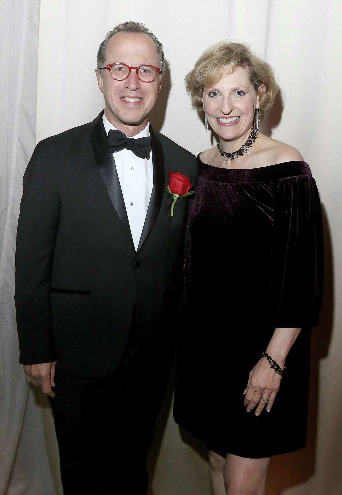 Albanyy, NY - October 30, 2019 - (Photo by Joe Putrock/Special to the Times Union) - Grammy Award-winning Albany Symphony Orchestra Conductor and 2019 Community Laureate David Alan Miller, left, and his wife Andrea Oser during the University at Albany Foundationa€™s 40th Annual Citizen Laureate Awards dinner at the UAlbany SEFCU Arena.
