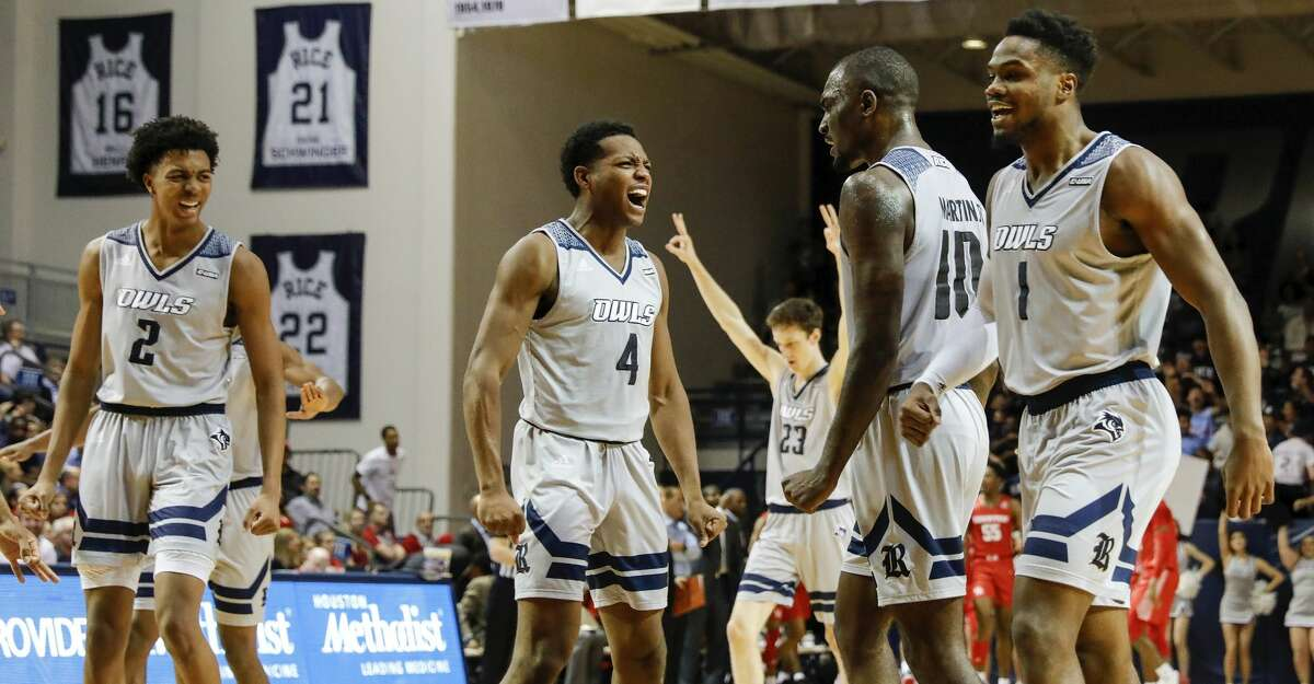 Rice Owls guard Quincy Olivari (4) congratulates forward Robert Martin (10) after a three point shot during the first half of the NCAA basketball game between the Rice Owls and the Houston Cougars at Tudor Fieldhouse in Houston, TX on Tuesday, November 19, 2019. The Cougars defeated the Owls 97-89.
