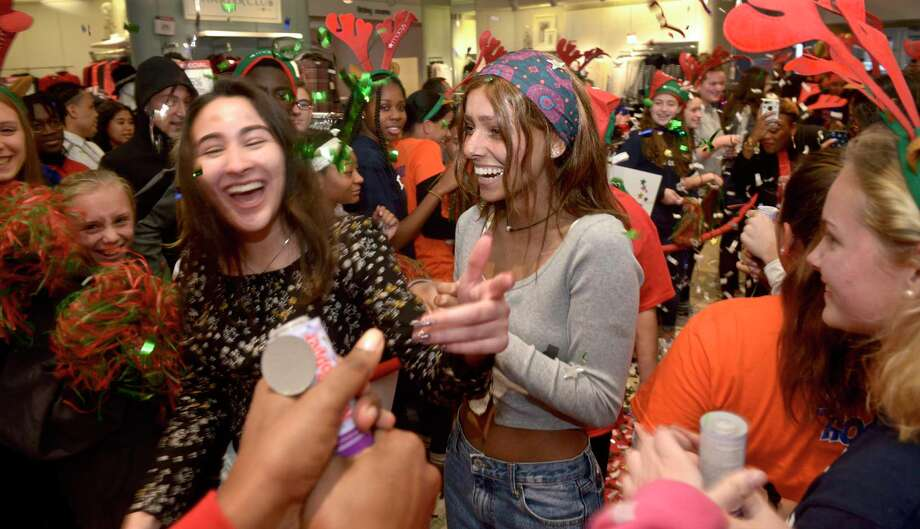 Alexandra Chakar, right, of Danbury, and her best friend Kayla Morais walk through a crowd of supporters as Chakar had her wish to go to Australia granted by Macy's, Danbury Fair mall, and Make-A-Wish Connecticut at a celebration at the store on Wednesday afternoon. Chakar, who is battling leukemia, will travel to Australia in the spring. November 20, 2019, in Danbury, Conn. Photo: H John Voorhees III / Hearst Connecticut Media / The News-Times