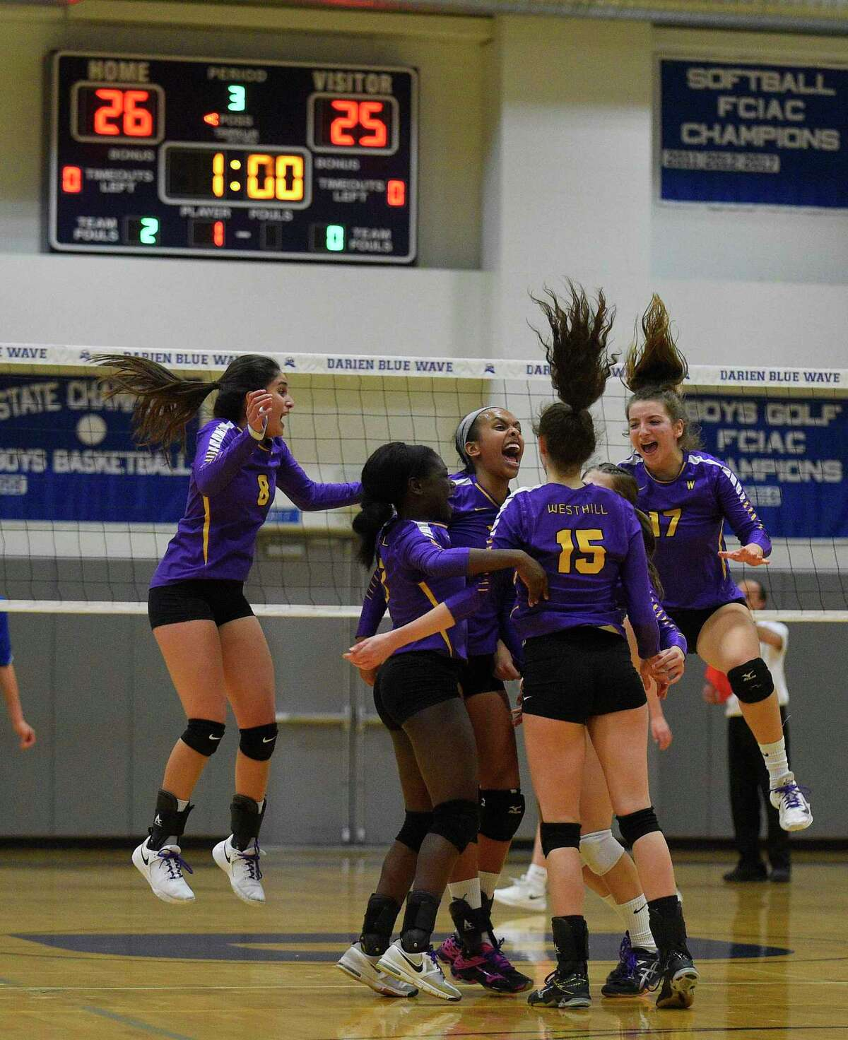 Westhill celebrates after defeating Fairfield Ludlowe 3-0 in the CIAC Class LL girls volleyball semifinal in Darien, Connecticut, Nov. 20, 2019.
