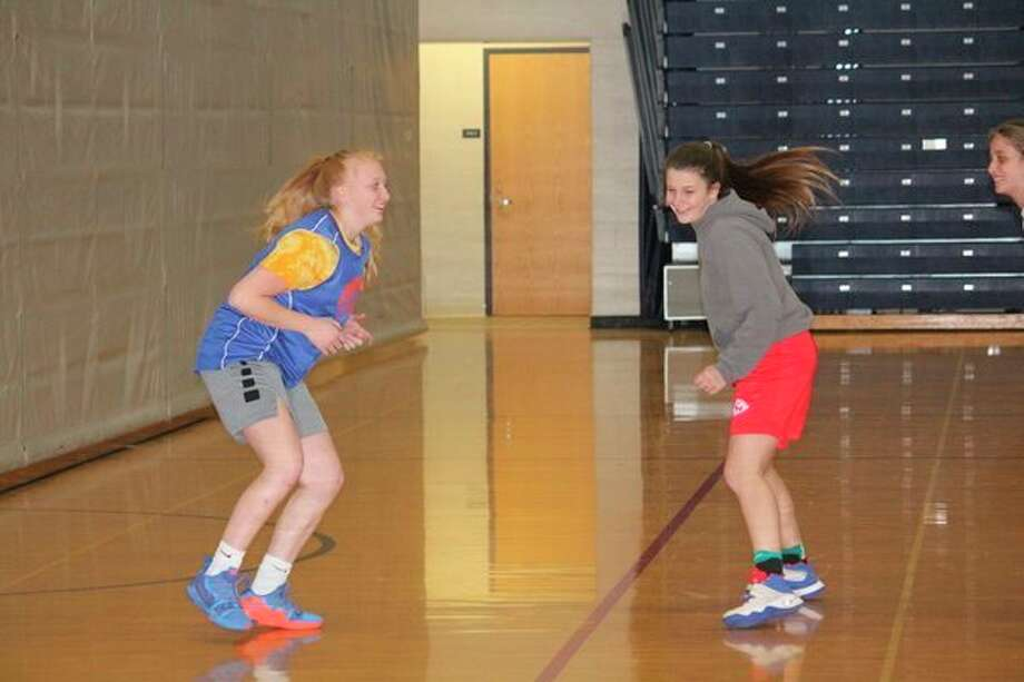 Kendra Ray (left) and Addison Fate work on conditioning during a Chippewa Hills basketball practice on Tuesday. (Pioneer photo/John Raffel)