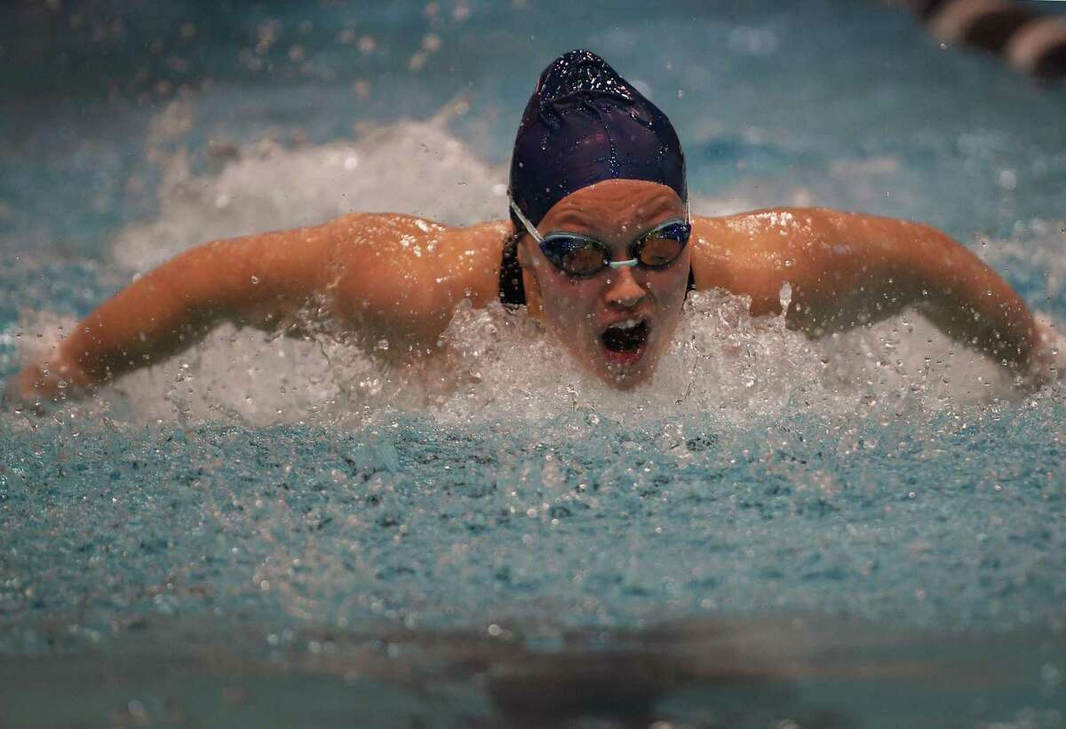 Foran's Jordan Macdonald swims to victory in the 100 Butterfly with a time of 57.53 at the CIAC Class M girls swimming championships at Southern Connecticut State University in New Haven, Conn. on Wednesday, November 20, 2019.