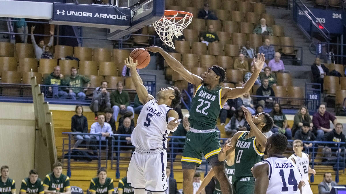 Siena's Jalen Pickett blocks the shot of Yale's Azar Swain during their game Wednesday, Nov. 20, 2019, at Lee Amphitheater. (Steven Musco / Special to the Times Union)