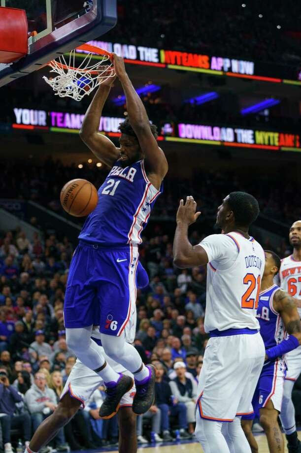 Philadelphia 76ers' Joel Embiid, left, dunks the ball as New York Knicks' Damyean Dotson, right, looks on during the second half of an NBA basketball game, Wednesday, Nov. 20, 2019, in Philadelphia. The 76ers won 109-104. (AP Photo/Chris Szagola) Photo: Chris Szagola / Copyright 2019 The Associated Press. All rights reserved.