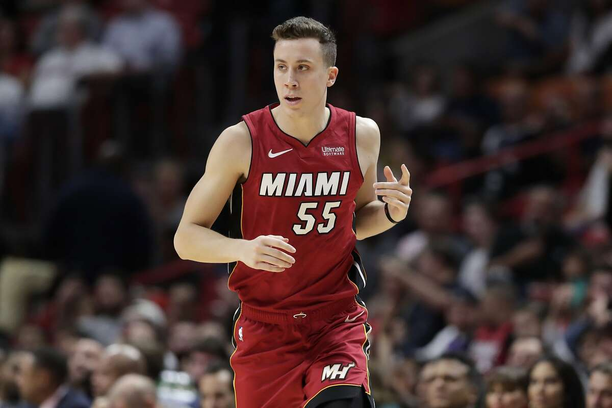 Miami Heat forward Duncan Robinson (55) reacts after shooting as three-pointer during the first half of an NBA basketball game against the Cleveland Cavaliers, Wednesday, Nov. 20, 2019, in Miami. (AP Photo/Lynne Sladky)