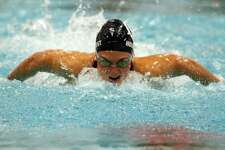 Wilton's Ellen Holmquist competes in the 200 IM during girls swimming action in Middletown, Conn., on Wednesday Nov. 20, 2019.