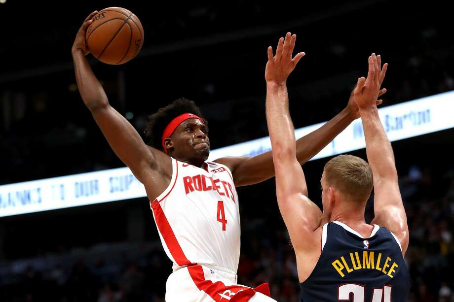 DENVER, COLORADO - NOVEMBER 20: Danuel House Jr. #4 of the Houston Rockets takes the ball to the basket against Mason Plumlee #24 of the Denver Nuggets in the second quarter at the Pepsi Center on November 20, 2019 in Denver, Colorado. NOTE TO USER: User expressly acknowledges and agrees that, by downloading and or using this photograph, User is consenting to the terms and conditions of the Getty Images License Agreement. (Photo by Matthew Stockman/Getty Images) Photo: Matthew Stockman/Getty Images