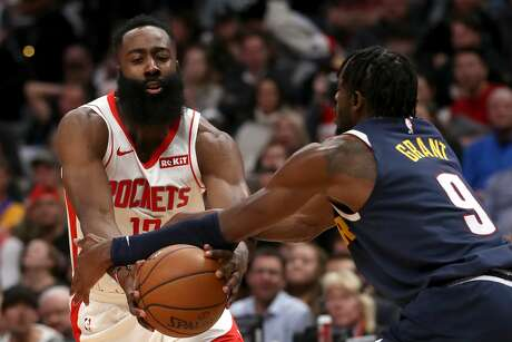 DENVER, COLORADO - NOVEMBER 20: James Harden #13 of the Houston Rockets drives against Jerami Grant #9 of the Denver Nuggets in the second quarter at the Pepsi Center on November 20, 2019 in Denver, Colorado. NOTE TO USER: User expressly acknowledges and agrees that, by downloading and or using this photograph, User is consenting to the terms and conditions of the Getty Images License Agreement. (Photo by Matthew Stockman/Getty Images)