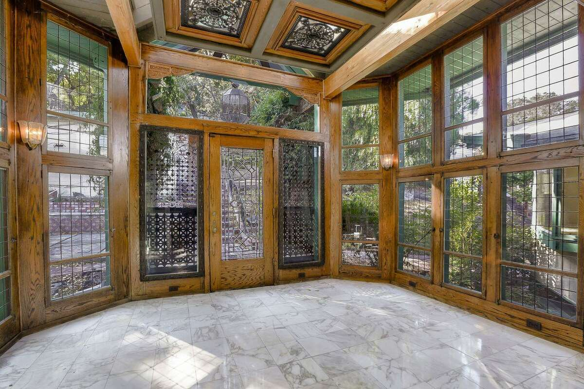 The two-story addition was designed around six antique stained glass windows.