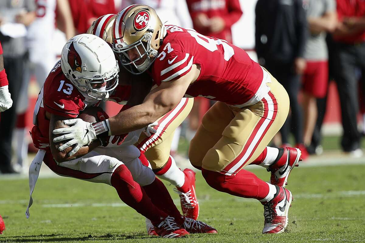 Arizona Cardinals wide receiver Christian Kirk (13) is tackled by San Francisco 49ers defensive end Nick Bosa (97) and free safety Jimmie Ward, rear, during the first half of an NFL football game in Santa Clara, Calif., Sunday, Nov. 17, 2019. (AP Photo/Josie Lepe)