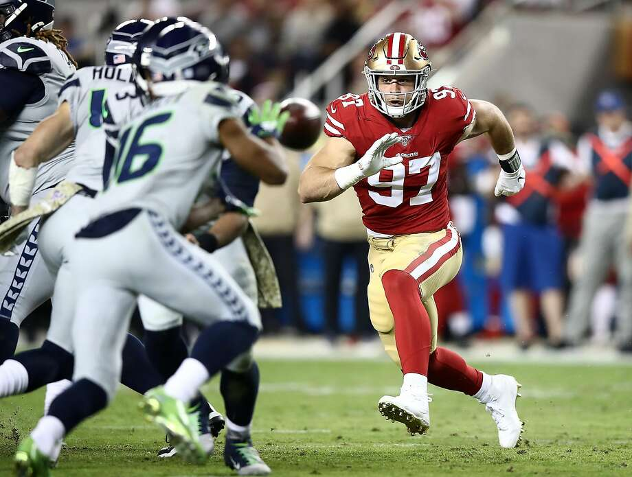SANTA CLARA, CALIFORNIA - NOVEMBER 11: Defensive end Nick Bosa #97 of the San Francisco 49ers rushes the offense of the Seattle Seahawks in the game at Levi's Stadium on November 11, 2019 in Santa Clara, California. (Photo by Ezra Shaw/Getty Images) Photo: Ezra Shaw / Getty Images