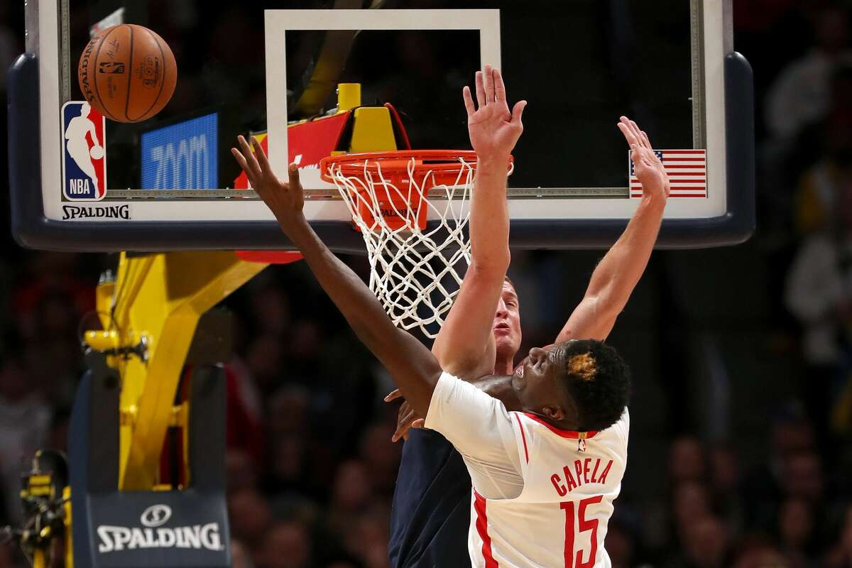 DENVER, COLORADO - NOVEMBER 20: Clint Capela #15 of the Houston Rockets is blocked going to the basket by Mason Plumlee #24 of the Denver Nuggets in the fourth quarter at the Pepsi Center on November 20, 2019 in Denver, Colorado. NOTE TO USER: User expressly acknowledges and agrees that, by downloading and or using this photograph, User is consenting to the terms and conditions of the Getty Images License Agreement. (Photo by Matthew Stockman/Getty Images)