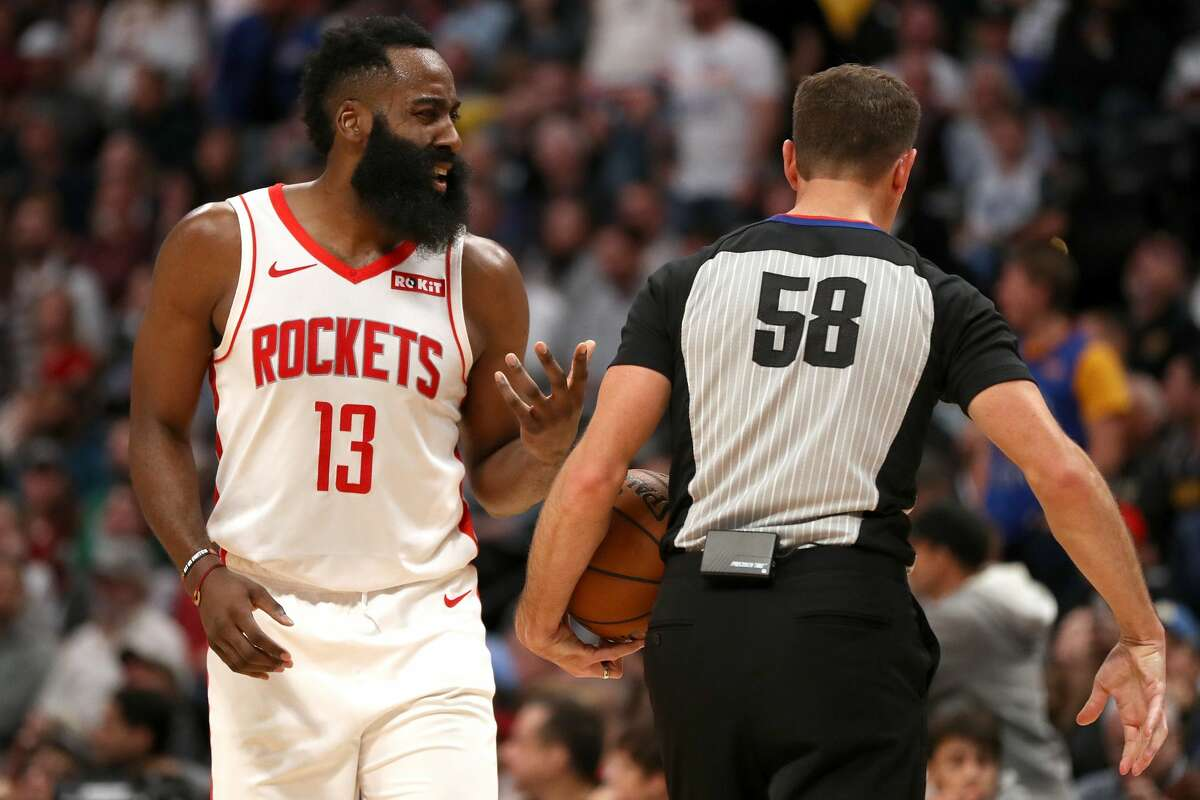 DENVER, COLORADO - NOVEMBER 20: James Harrden #13 of the Houston Rockets disputes a call with referee Josh Tiven #58 while playing the Denver Nuggets in the fourth quarter at the Pepsi Center on November 20, 2019 in Denver, Colorado. NOTE TO USER: User expressly acknowledges and agrees that, by downloading and or using this photograph, User is consenting to the terms and conditions of the Getty Images License Agreement. (Photo by Matthew Stockman/Getty Images)