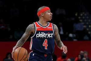 WASHINGTON, DC - NOVEMBER 20: Isaiah Thomas #4 of the Washington Wizards dribbles the ball against the San Antonio Spurs at Capital One Arena on November 20, 2019 in Washington, DC.  NOTE TO USER: User expressly acknowledges and agrees that, by downloading and/or using this photograph, user is consenting to the terms and conditions of the Getty Images License Agreement.
