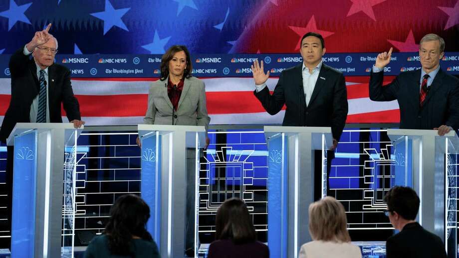 Democratic candidates Bernie Sanders, Kamala Harris, Andrew Yang and Tom Steyer look to make their point on the debate stage on Wednesday night. Photo: Washington Post Photo By Melina Mara / The Washington Post