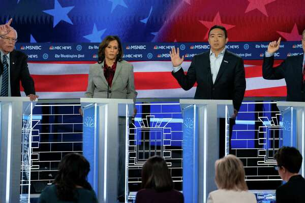 Democratic candidates Bernie Sanders, Kamala Harris, Andrew Yang and Tom Steyer look to make their point on the debate stage on Wednesday night.