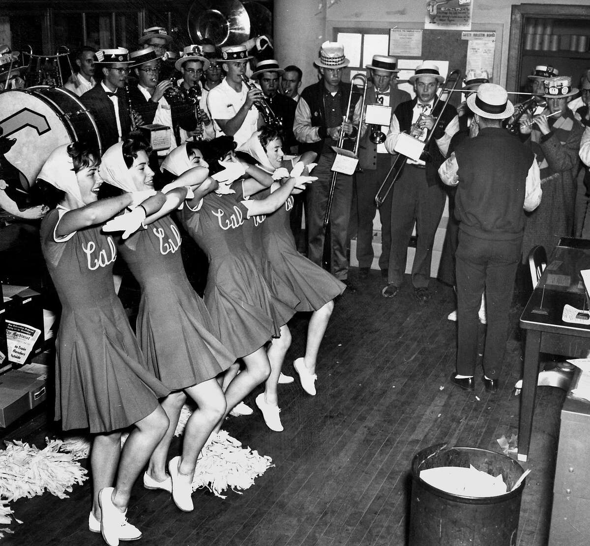 Nov. 23, 1961: The UC Berkeley marching band and cheerleaders perform in the San Francisco Chronicle newsroom in 1961.