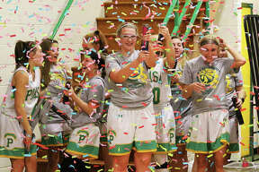 Southwestern's Annie Gallaher (middle) shoots off a confetti cannon as teammates celebrate coach Steve Wooley's 500 win Wednesday night in Piasa.