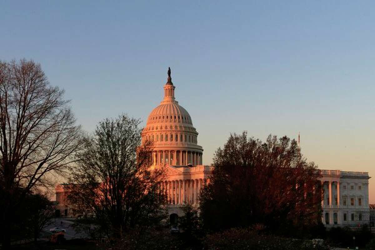 In this April 5, 2017, file photo, the Capitol is seen at sunrise in Washington. At a time when many Americans say they're struggling to distinguish between fact and fiction, the country is broadly skeptical that facts underly some of the basic mechanisms of democracy in the United States - from political campaigns to voting choices to the policy decisions made by elected officials. (AP Photo/J. Scott Applewhite)