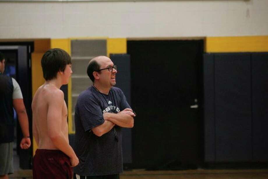 Baldwin boys basketball coach JJ Eads (right) watches the action during a practice on Monday. (Pioneer photo/John Raffel)
