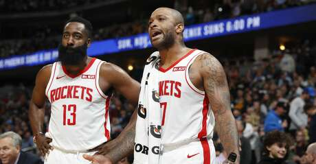 Houston Rockets forward PJ Tucker, right, and guard James Harden argue with referees late in the second half of the team's NBA basketball game against the Denver Nuggets on Wednesday, Nov. 20, 2019, in Denver. The Nuggets won 105-95. (AP Photo/David Zalubowski)