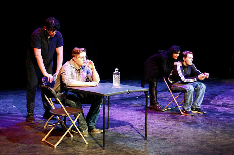 "Justin Flores (from left) as Tormentor hounds an alcoholic played by Willem Kline as Tempter, played by Sage Vasquez, encourages the man's son — a video game addict played by Joshua Knight — to continue playing. Flores and Vasquez came up with the idea for their characters and wrote their parts in the Illinois College play ""Surviving Yourself: Stories of Addiction."" Cast members rehearse a scene Tuesday from the Illinois College first-year seminar play ""Surviving Yourself: Stories of Addiction."" Photo: Photo Provided"