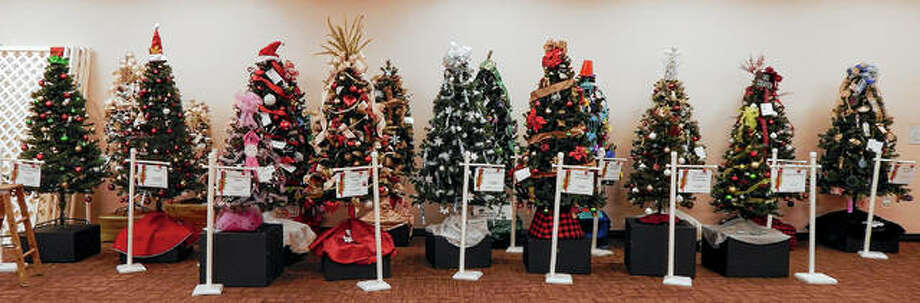 Decorated trees line a wall Wednesday at Pathway Services as they await placement ahead of this weekend's Festival of Trees. Photo: Angela Bauer | Journal-Courier