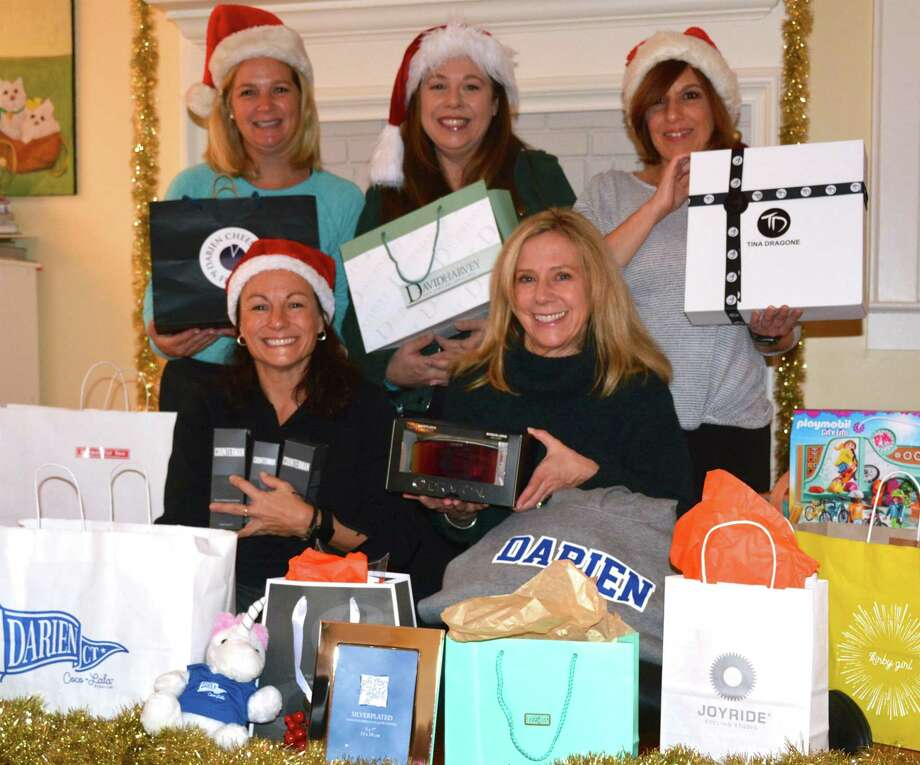 DAC Board members Meg Deluca, Angela Riley, Adrienne Kelly and Andrea Jackson surrounded by Oh Christmas Spree! prizes. Photo: DAC / Contributed Photo