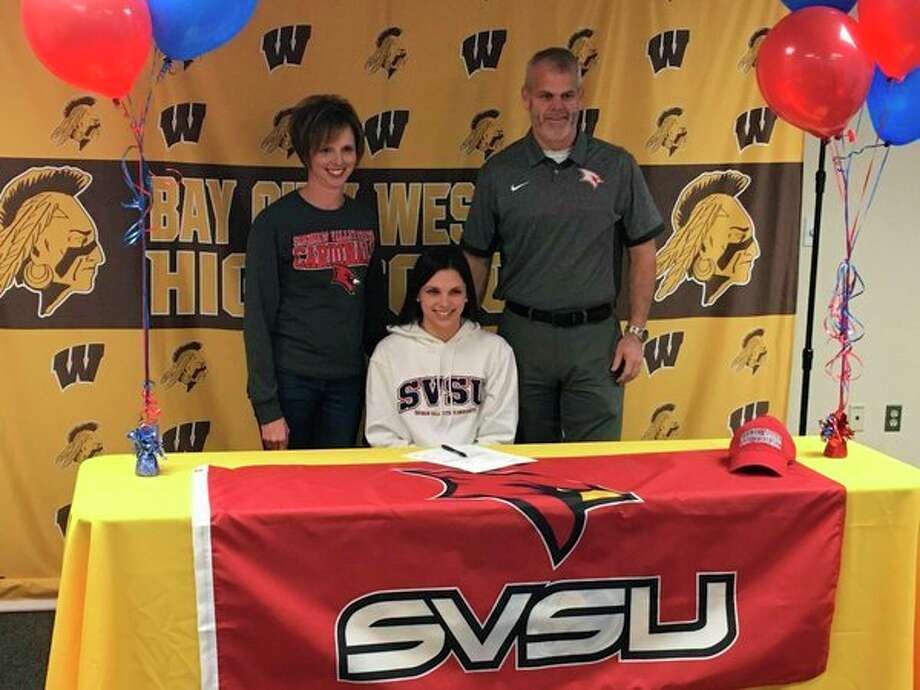 Bay City Western's Hannah Lytle is shown with her parents after signing a letter of intent with the Saginaw Valley State University swim program recently.