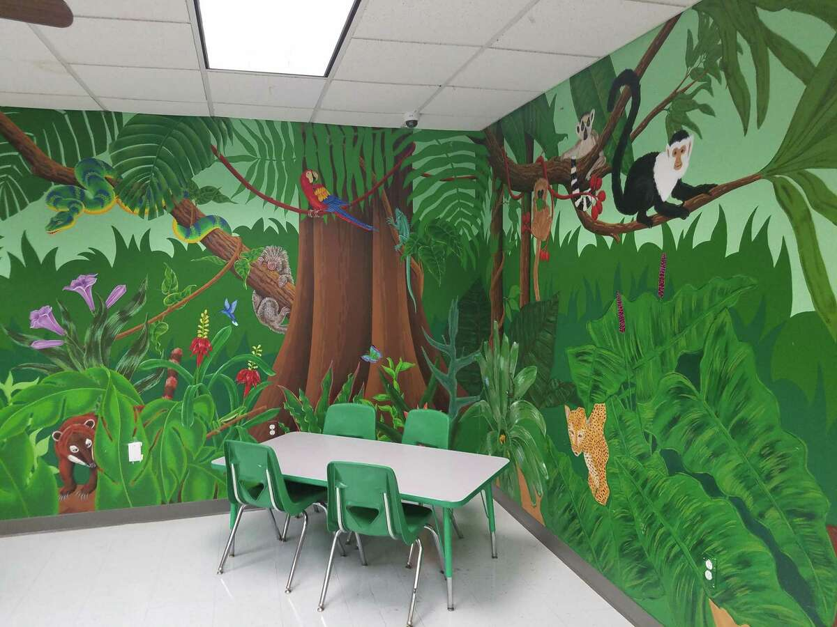 The childrens' rooms in the shelter is decorated to look like a rain forest. Through a process called