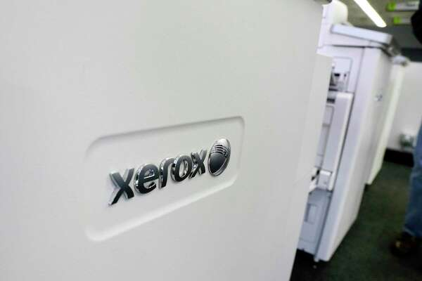 "FILE - This Tuesday, May 24, 2016, file photo shows Xerox copiers at a store, in North Andover, Mass. Computer and printer maker HP Inc. said Wednesday, Nov. 6, 2019, that it has received a ""proposal"" from copier maker Xerox and has had conversations ""from time to time"" with the company about a potential business combination. (AP Photo/Elise Amendola, File)"