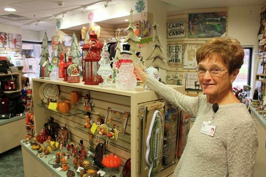 Spectrum Health Big Rapids and Reed City Hospitals Auxiliary member Sally Nelson is shown at the gift shop in the Big Rapids Hospital. Many unique holiday items are available, giving community members, employees and visitors a chance to buy items while supporting hospital projects. (Courtesy photo)