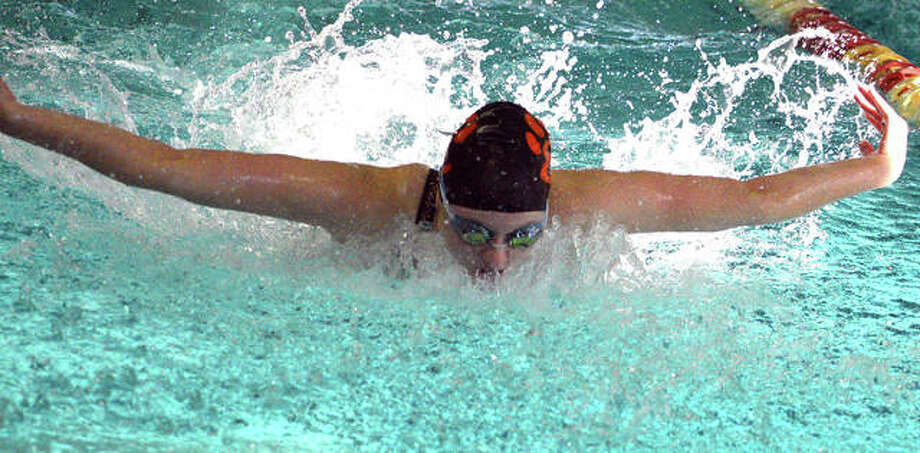 Edwardsville junior Allison Naylor swims in the 100-yard butterfly during last Saturday's Springfield High Sectional at Eisenhower Pool. Photo: Scott Marion/The Intelligencer