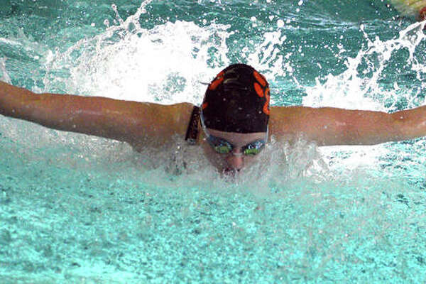 Edwardsville junior Allison Naylor swims in the 100-yard butterfly during last Saturday's Springfield High Sectional at Eisenhower Pool.