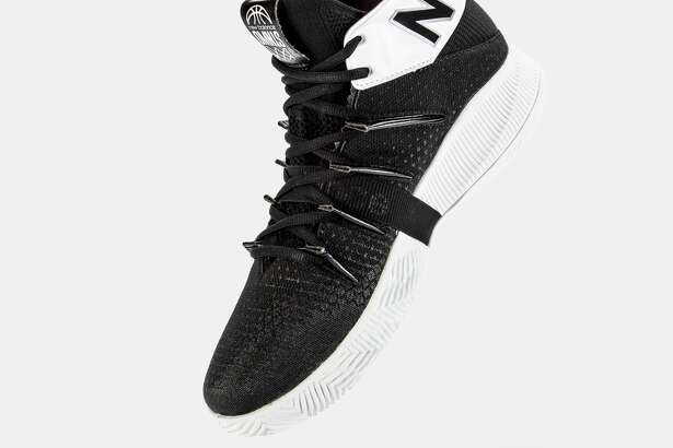 """Dejounte Murray is featured in a new ad promoting the New Balance OMN1s colorway """"Light's Out."""" Murray is the newest member of the NB basketball family, joining former Spur Kawhi Leonard and Oklahoma City Thunder's Darius Bazley."""