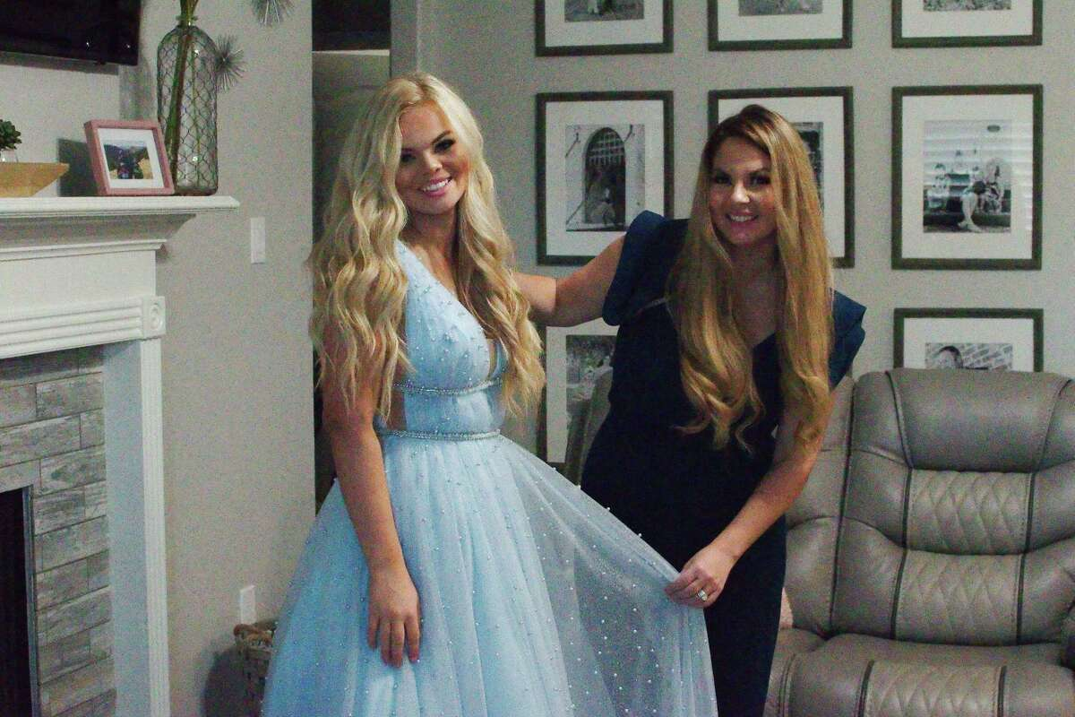 Miss Texas Teen USA pageant contestant Jadym Diem stands with her mother Cristin Johnson as she poses in a dress.