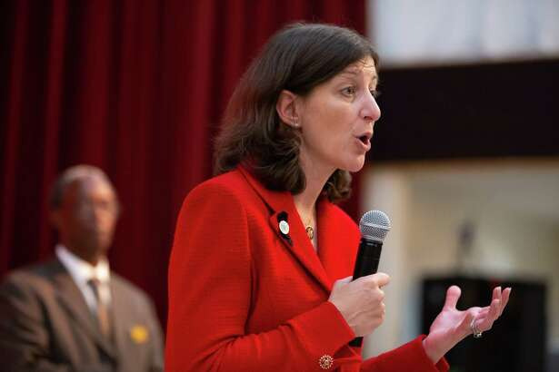 Rep. Elaine Luria, D-Va., answers questions from her constituents during a town hall at New Hope Baptist Church in Virginia Beach, Va., on Oct. 3.