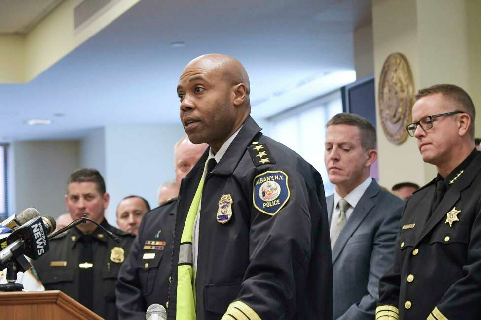 Surrounded by members of the New York State Sheriffs' Association, New York State Association of Chiefs of Police, and District Attorneys Association of the State of New York, Albany Police Chief Eric Hawkins speaks at a press conference at the Albany County Judicial Building on Thursday, Nov. 21, 2019, in Albany, N.Y. Those in attendance at the press conference said that they are concerned about the criminal justice reforms that will take effect on January first of next year. (Paul Buckowski/Times Union)