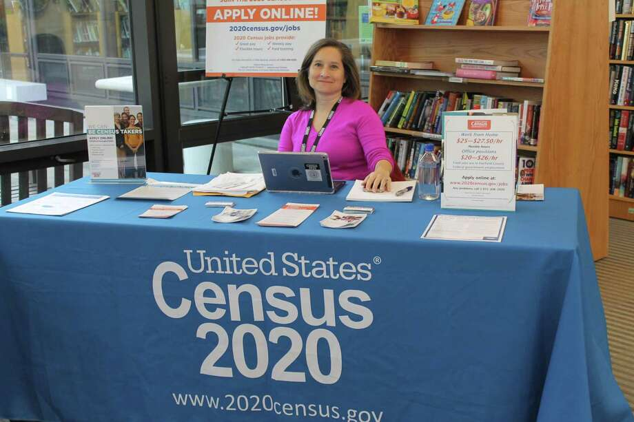 Jennifer Forman mans a Census 2020 desk at Wilton Library on Nov. 14. She will be back on Nov. 29. Photo: Contributed Photo / Janet Crystal / Wilton Bulletin Contributed