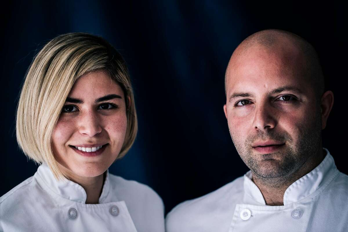 Laura and Sayat Ozyilmaz, owners and executive chefs of Noosh, pose for a photo together at their restaurant in San Francisco, Calif. on Tuesday, September 17, 2019.