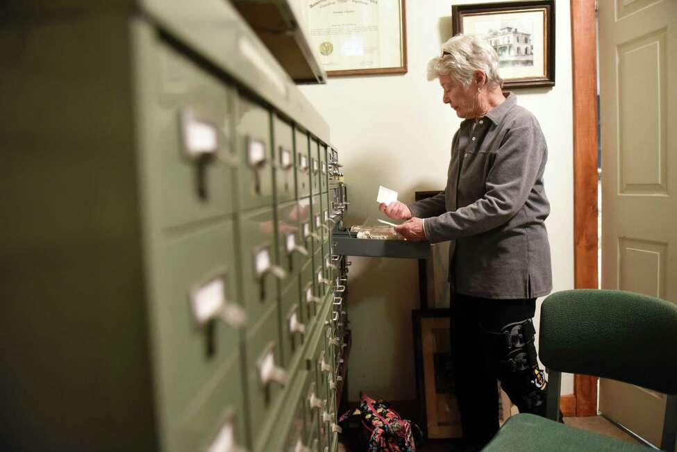 Beverley McClave, president of the Stephentown Historical Society, looks through archive index cards for information on Whiting Sweeting on Monday, Nov. 18, 2019, at the Stephentown Heritage Center in Stephentown, N.Y. Sweeting killed Albany Constable Darius Quimby on January 3, 1791. Quimby was the first police officer killed in the line of duty in the U.S. (Will Waldron/Times Union)