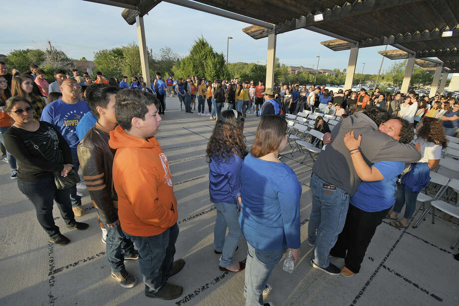 Paula Garcia, mother of former United High School football player Jalen Garcia, who passed away recently of cancer, is comforted by one of many who attended a memorial in his honor, Saturday, November 16, 2019 at North Central Park. Photo: Cuate Santos/Laredo Morning Times