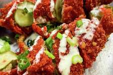 Hot Cheetos-crusted pickles Where to find them: Texas Fare in section 123 $6
