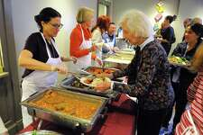 "Westport resident Jeanne Holleman is served Thanksgiving dinner during Saugatuck Congregational Church's 47th Annual Community Thanksgiving Feast in Westport, Conn., on Thursday Nov. 23, 2017. According to the church's website, ""For over 40 years, Saugatuck has been holding Community events on Thanksgiving and Christmas Day that are free and open to everyone - young families, homeless people, older folks, anyone who might otherwise be alone."" For more information on attending or volunteering go to: http://saugatuckchurch.org/"