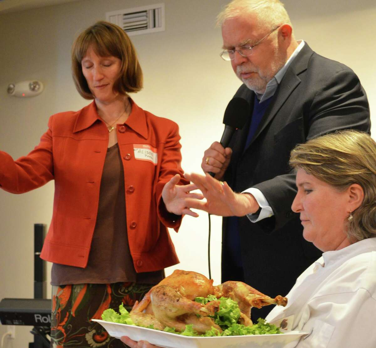 Blessing of the first bird at the Thanksgiving community feast, held by kitchen manager Paula Mikesh, was made by the Revs. Alison Patton of Saugatuck Congregational Church and John Morehouse of the Unitarian Church.
