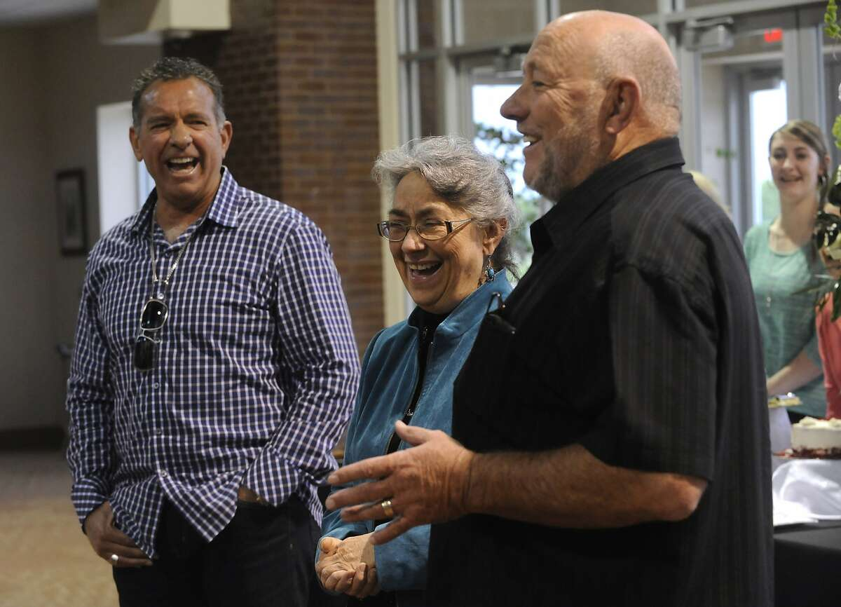 Ronald W. Erdrich/Reporter-News Farris Wilks, right and his brother Dan laugh with their sister Beth Maynard while telling a story about her time working for their company, Tuesday evening, April 23, 2013. Maynard started working for her brothers in 1978 and retired this week.