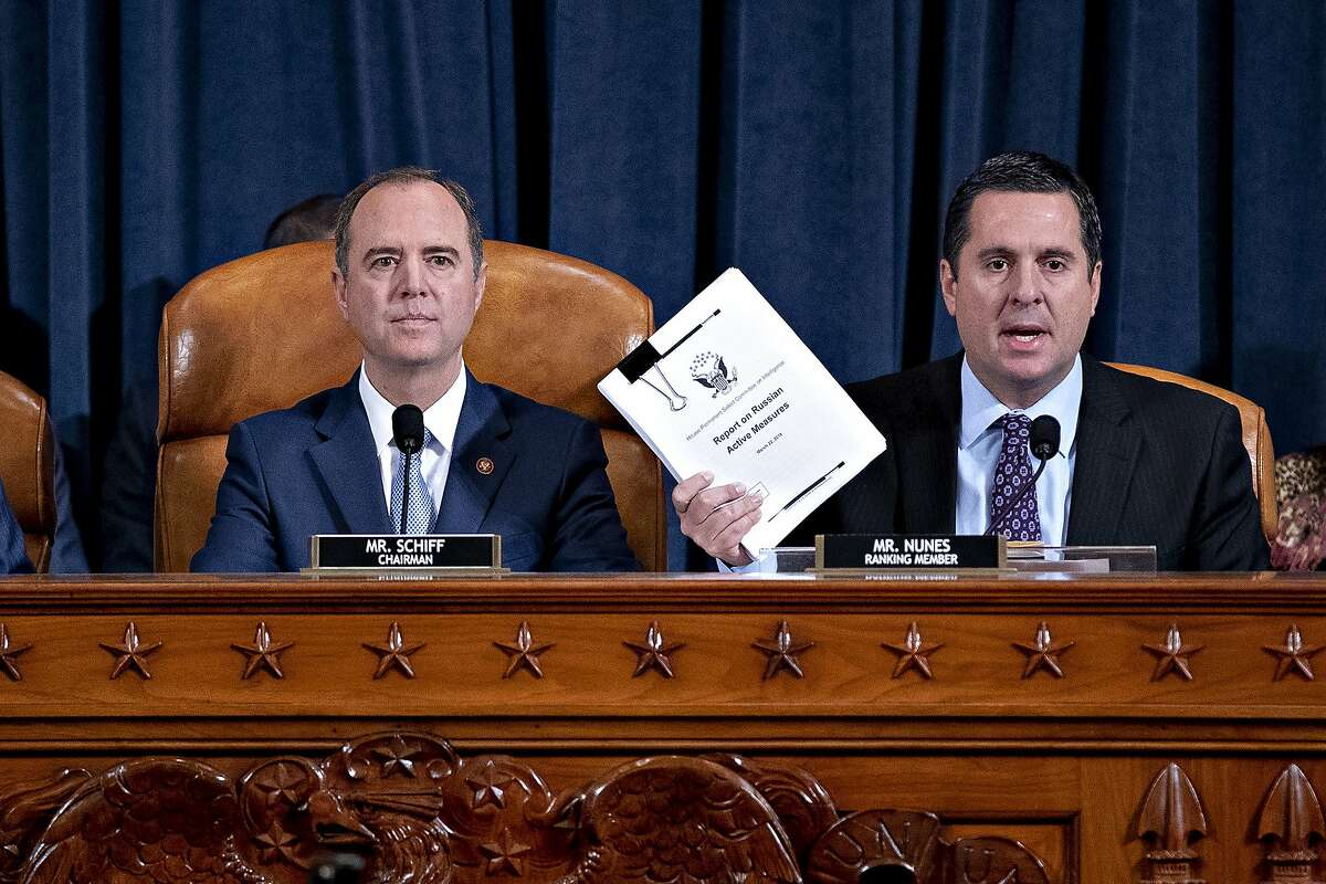 Rep. Devin Nunes, R-Calif., right, the ranking member of the House Intelligence Committee, joined by Chairman Adam Schiff, D-Calif., left, holds up a document he is submitting as the panel prepares to listen to former White House national security aide Fiona Hill, and David Holmes, a U.S. diplomat in Ukraine, on Capitol Hill in Washington, Thursday, Nov. 21, 2019, during a public impeachment hearing of President Donald Trump's efforts to tie U.S. aid for Ukraine to investigations of his political opponents.