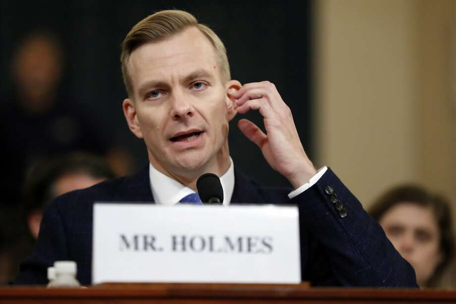 David Holmes, a U.S. diplomat in Ukraine, testifies before the House Intelligence Committee on Capitol Hill in Washington, Thursday, Nov. 21, 2019, during a public impeachment hearing of President Donald Trump's efforts to tie U.S. aid for Ukraine to investigations of his political opponents. (AP Photo/Andrew Harnik) Photo: Andrew Harnik, Associated Press