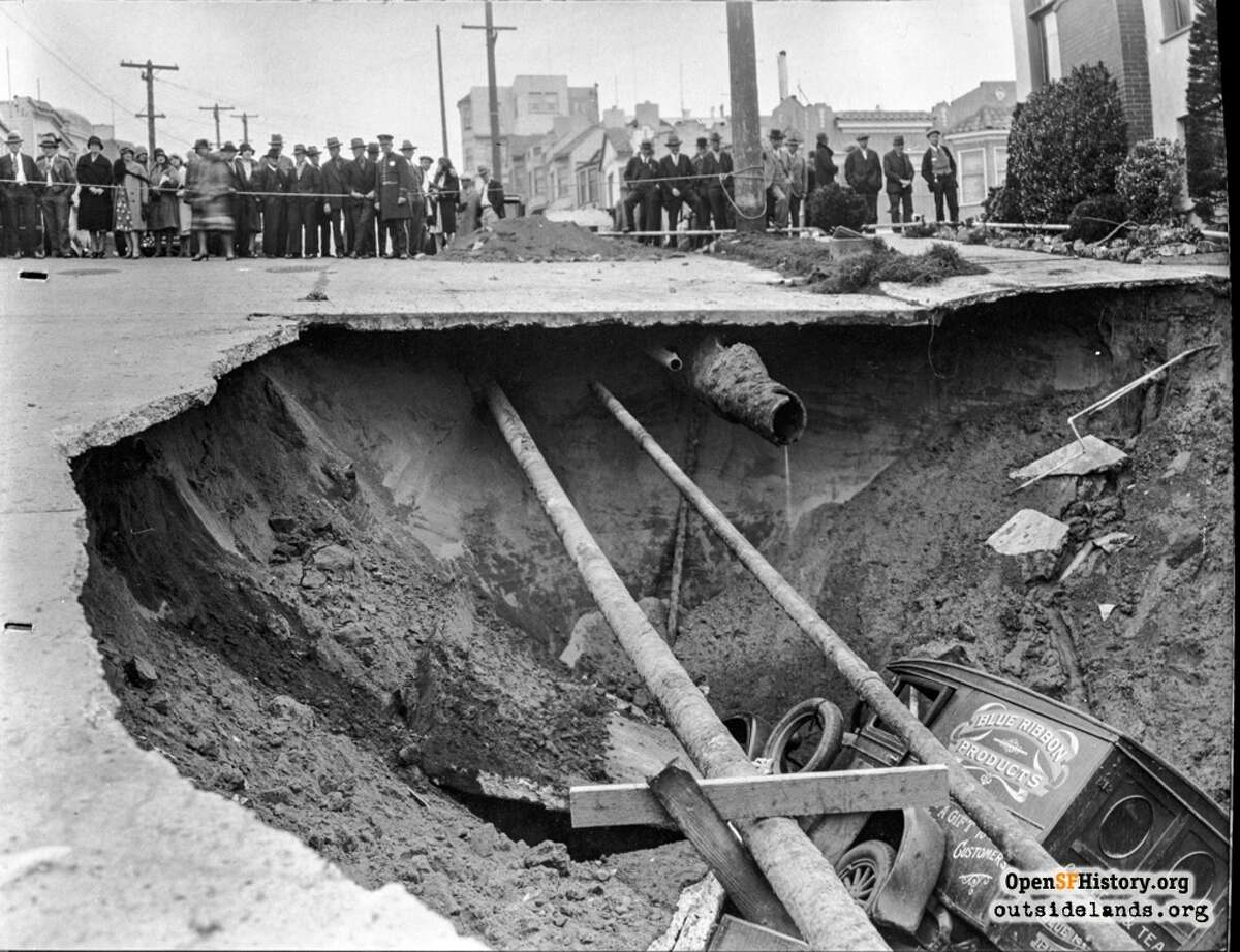 This collapsed pavement on 47th Avenue on March 18, 1930, was caused by a leaking salt water main that washed away the sand underneath it. The coffee and tea delivery truck stuck in the hole belonged to T.R. Capener, who first spotted the leak. Also broken in the cave-in was the city's freshwater main and a PG&E gas main, which led to the explosion of a house. (Photo: Western Neighborhoods Project - wnp36.10013)