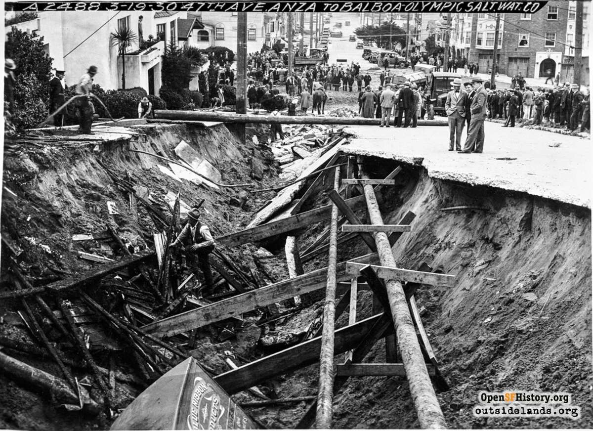 This collapsed pavement on 47th Avenue on March 18, 1930, was caused by a leaking salt water main that washed away the sand underneath it. Also broken in the cave-in was the city's freshwater main and a PG&E gas main, which led to the explosion of a house. (Photo: Western Neighborhoods Project - wnp36.04514)